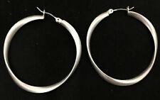 Pretty silver tone stwist / wave hoop earrings