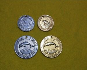 Sea World ride tokens 2 x ADULT Dolphin & 2 x CHILD Half Dolphin