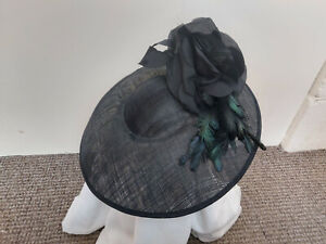 Fantastic Black With feathers and flower Fascinator
