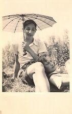 RPPC Unknown Young Couple in grass with Parasol German? - Vintage POSTCARD
