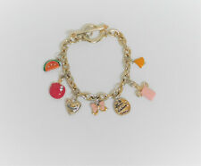 Cute Gold and Silver Juicy Couture Charm Bracelet with Seven Charms