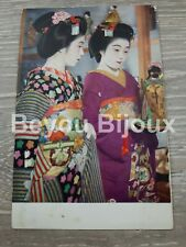 Vintage Geisha Girls admiring a Geisha Doll Postcard nice colour detail.