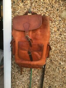 Large tan raw leather backpack