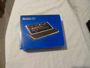 "Nokia E7 E7-00 QWERTY 4.0"" Touch Screen Slide 16GB 3G WIFI Unlocked Pristine"