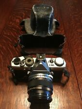 Olympus OM-1 35mm SLR film camera with 50 mm lens and case