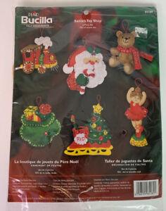 PLAID BUCILLA FELT CHRISTMAS ORNAMENTS #85189 SANTA'S TOY SHOP 6 ORNAMENTS 2005