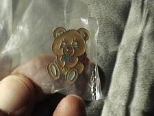 """Red Ribbon Metal Pin. 1"""" tall Gold-tone Smiling Honey Bear Animal wearing a"""