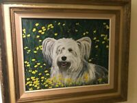 "Framed original oil painting of a dog in a field of flowers. overall 24""x28"""