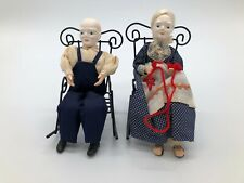 A pair of Vintage Shackman Porcelain Dolls in Rocking Chairs