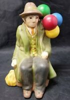 "Ceramic Man Sitting w 6 Balloons Figurine, 1980, 7"" Tall, Green Jacket Hat, Vest"