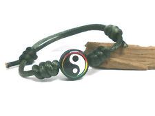 "Pulsera artesanal "" DAY "" charm yin yang  y cordón verde oscuro"