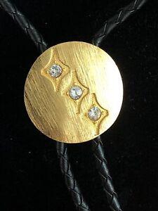 "Vtg Bolo Tie w Gold Tone Brass And Cubic Zirconia Round Slide Black String 36"""