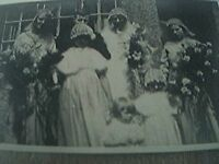 postcard size r/p old undated 7 people old wedding outside windows house