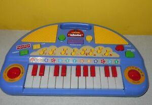 Fisher-Price Teaching Tunes / Light-Up Keys Keyboard Music & Nursery Rhymes
