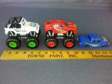 LOT OF 2 MONSTER JAM INTERCHANGEABLE FRAME AND CHASSIS WITH 3rd. CHASSIS 1:64