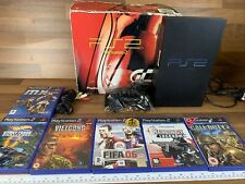 Boxed Sony PlayStation 2 Black console, 6 games and one controller.