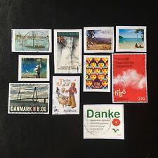 Lot de 10 timbres - Pays divers et années diverses - encore sur frag - F21