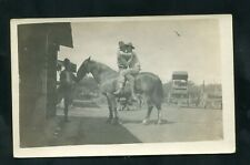 RPPC young men affectionate soldiers sitting embraced HORSE real photo postcard
