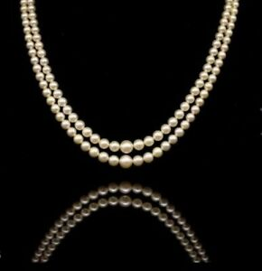 Mikimoto pearl double strand necklace boxed,. The silver clasp is marked M sil.