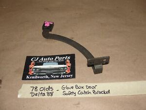 OEM 1978 78 Olds Delta 88 DASH GLOVE BOX DOOR SAFETY LATCH CATCH ARM BRACKET