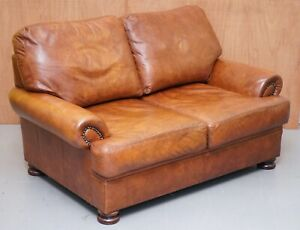 TETRAD CORDOBA BROWN LEATHER TWO SEATER SOFA WITH STUD DETAIL