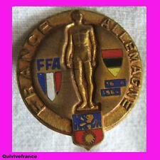 BG2958 INSIGNE FEDERATION FRANCAISE ATHLETISME FRANCE- ALLEMAGNE  1964