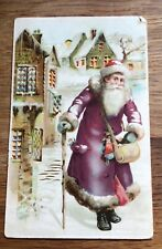 More details for santa xmas father christmas postcard c1910 purple robes hold to light