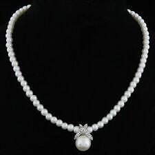 Collier esprit couture, avec perles nacrées fantaisie, croisillon et strass,neuf