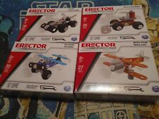 4 Sets of Erector by Meccano assorted Vehicles Car Plane Biplane Bulldozer