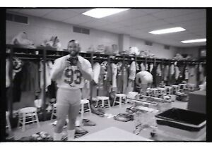 Two celluloid strips; 9 photos. Male Nudity. Football locker room. Gay interest