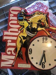 VINTAGE MARLBORO CIGARETTE SIGN WITH CLOCK, IMAGE OF COWBOY ON BUCKING HORSE