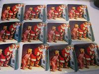 set 12 vintage Coca Cola Christmas Santa Claus advertising coasters with cork