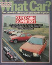 What Car? magazine 07/1983 featuring Ford, Vauxhall, Saab, Audi, BMW Alpina, VW
