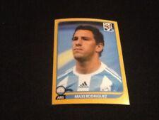 #117 Maxi Rodríguez Argentina Panini Copa del Mundo 2010 edición oro suizo Liverpool