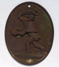 Cast iron fire mark  of man blowing an alarm on a bugle. 20thC. Repro.