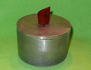 Heavy cast metal RUSTIC CANISTER w/ teakwood handle. Interior space 3.75 x 2.125