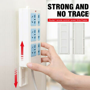 Seamless Punch-free Plug Sticker Holder Wall Fixer Power Strip Holders Storage.