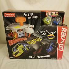 Fisher Price Rev N Go Stunt Garage Playset 2 Cars & Launcher 2012 BNIB Mattel