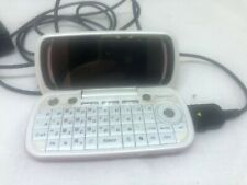 Pink Pantech Slide Keyboard Cell Phone Charges and Lights Up