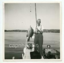 Man Pole Fishing Smoking Cigar Fish in Foreground Boat Vintage 1950s Photo