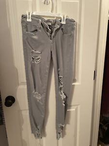 american eagle jeans size 4 super stretchy gray ripped jeans