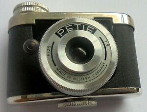 Rare Vintage Matex Petie Miniature Spy Camera with original brown leather case.