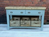 Butchers block table kitchen island with wooden crates.