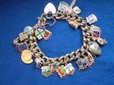 Stunning Heavy Vintage Silver Charm Bracelet with 27 Charms. 77.7 grams
