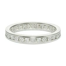 0.65 ct tw F/SI-1 Round Cut Diamond Channel Set Eternity Band in Platinum