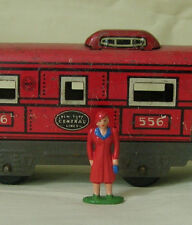 Woman passenger in red coat, O scale model train layout figure, Reproduction