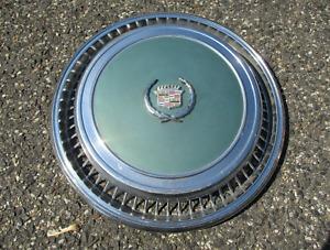 One genuine 1974 to 1978 Cadillac Eldorado hubcap wheel cover light blue