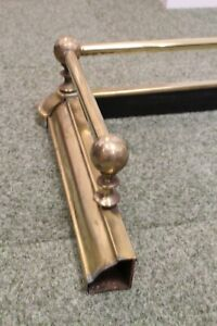 Gorgeous, heavy vintage brass fire guard with five round knobs