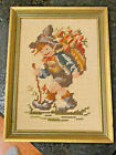 Antique Framed Needlepoint  mountain boy carrying backpack circa 1950's