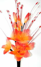 ORANGE RED ARTIFICIAL FLOWER ARRANGEMENT WITH GRASS.